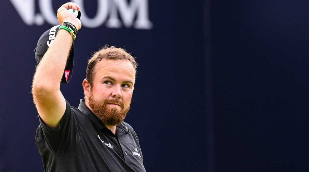 Shane Lowry waves to the crowd after his eight-under 63 on Saturday at Royal Portrush.