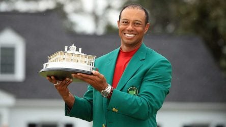 Tiger Woods holds up his Masters trophy after winning his fifth green jacket.