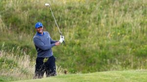 Tiger Woods hits a shot during the first round of the Open Championship.