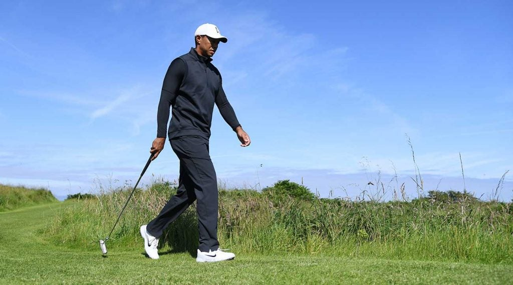 Tiger Woods walks Royal Portrush during a practice round ahead of the 2019 Open Championship.