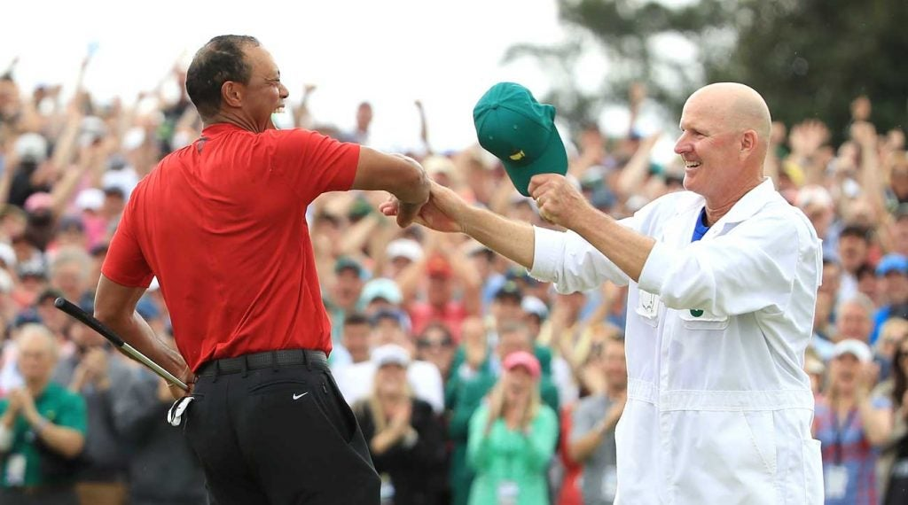 Tiger Woods and Joe LaCava after Woods won the 2019 Masters.