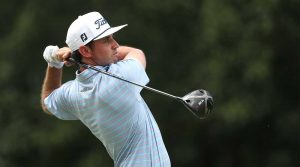 J.T. Poston hits a tee shot during the final round of the Wyndham Championship.