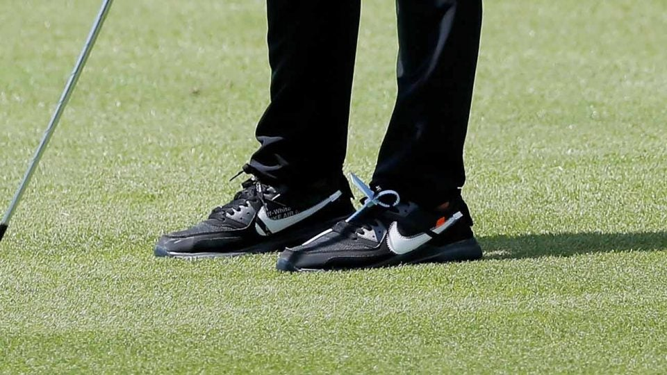 What's the odd-shaped item attached to Brooks Koepka's Nike shoes?