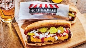 An ice-cold lager is the perfect pairing with Hot Dog Bills' iconic mashup.