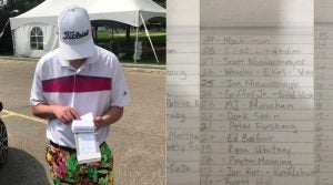 Jared du Toit's caddie, Nolan Renwick, checks out the yardage book for the week.