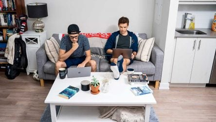 Matt (left) and Will's living room is typical of many a Millennial abode. The data they analyze and the way it's presented? Anything but typical.