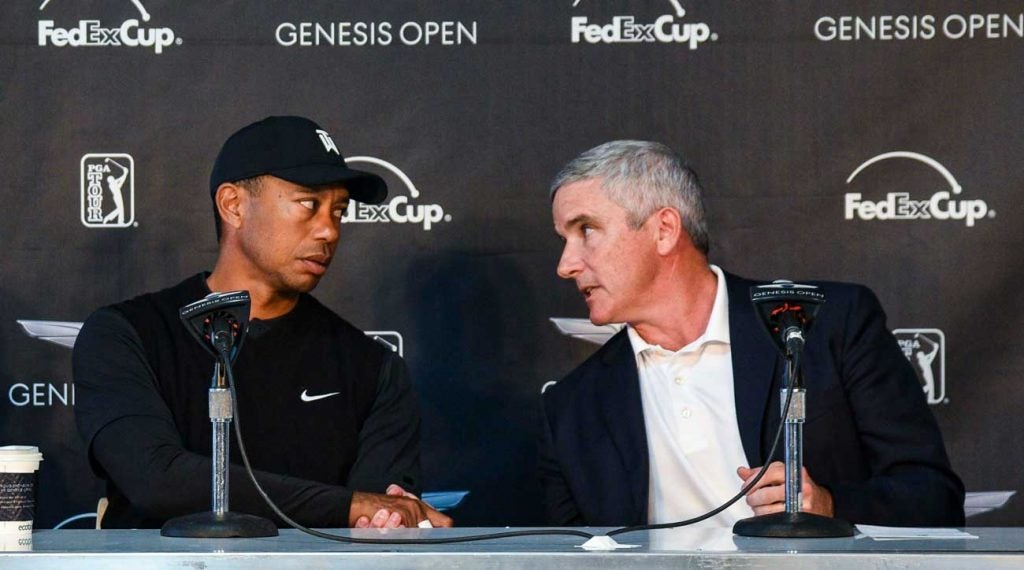 Tiger Woods with PGA Tour commissioner Jay Monahan in February.