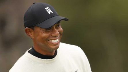 Tiger Woods smiles during a practice round.