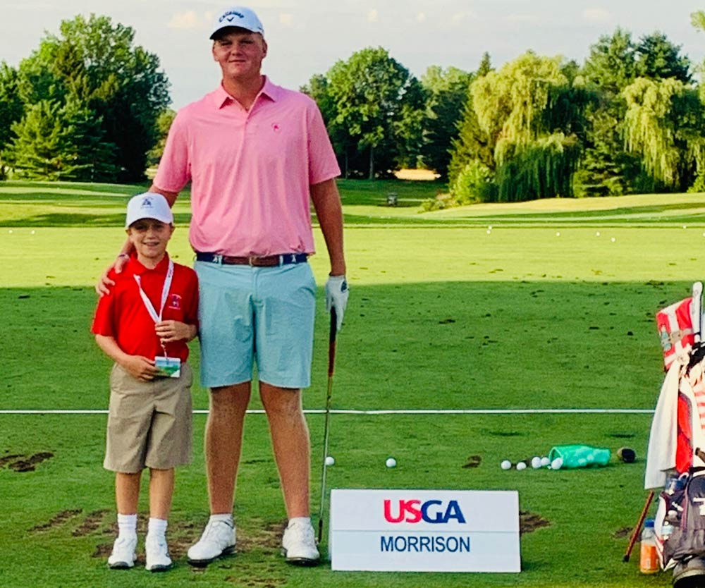 Tommy Morrison with a young aspiring golfer.