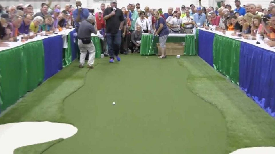 WATCH: Golfer drains 100-foot putt to win $25K - Golf