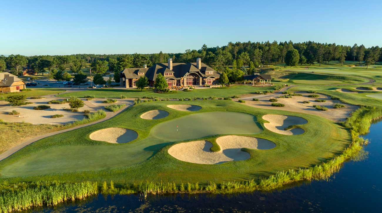 The clubhouse at Forest Dunes is a dramatic backdrop for a round's conclusion.