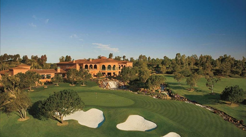 The grand clubhouse sits above the hilly property.