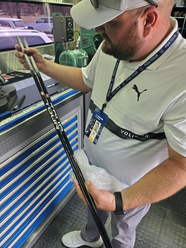 Cobra rep James Posey takes a look at Jason Dufner's LA Golf prototype iron shafts.