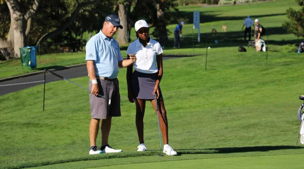 U.S. Senior Open champ Olin Browne chats with Shani Waite during their round together.