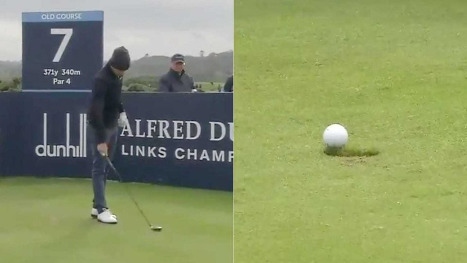 Joakim Lagergren pounds his club into the grass to tee up his ball at the Alfred Dunhill Links Championship.