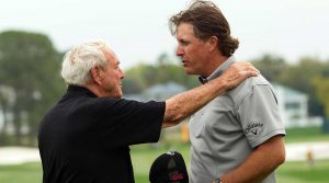 Arnold Palmer talks with Phil Mickelson during the 2010 Arnold Palmer Invitational at the Bay Hill.