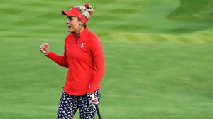 Lexi Thompson pumps her fist after she drained a birdie putt on the 18th green during her Friday four-balls match against Europe.