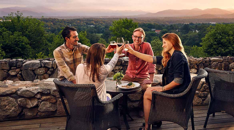 Guests enjoy an evening drink at Omni Grove Park Inn.