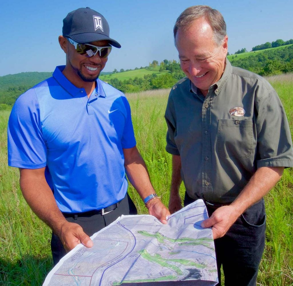 Tiger Woods and Big Cedar Lodge owner Johnny Morris look over a course blueprint.