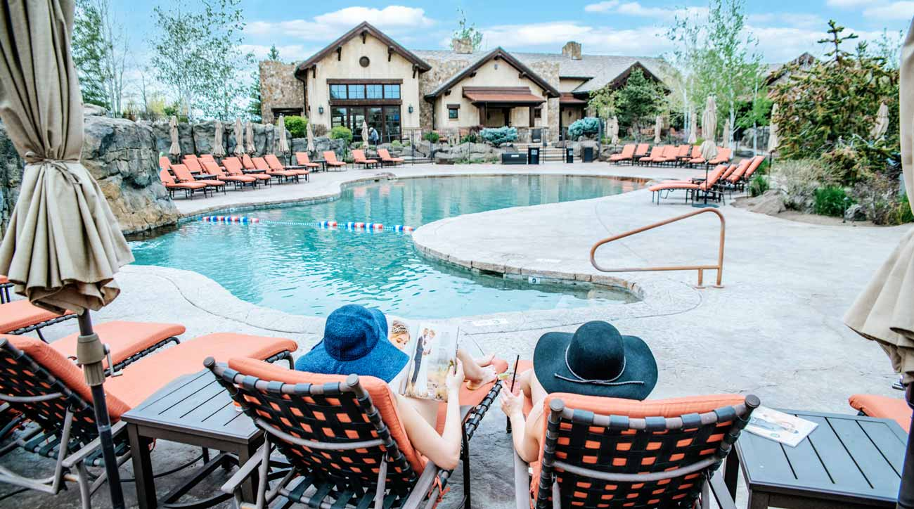 Guests relax poolside at Pronghorn Resort.