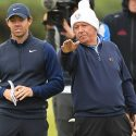 Rory McIlroy and his dad, Gerry, look over a shot at the Dunhill Links Championship in Scotland.