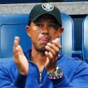 Tiger Woods claps while watching Rafa Nadal at the U.S. Open.