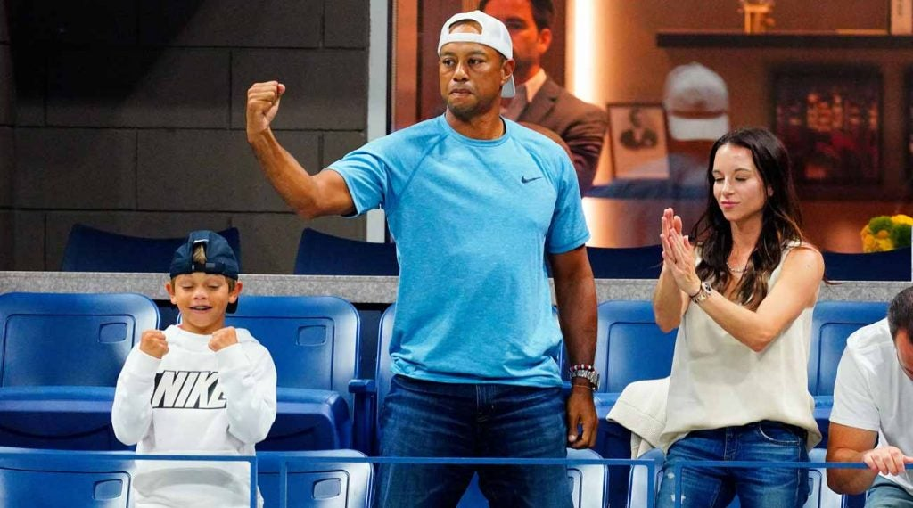 Tiger Woods with son Charlie (left) and girlfriend Erica Herman at the U.S. Open on Wednesday.