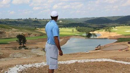 Tiger Woods surveys his Payne's Valley public golf course design