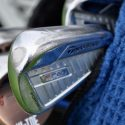 Jason Day's TaylorMade P760 irons reveals spots where the finish was stripped to insert tungsten slugs.