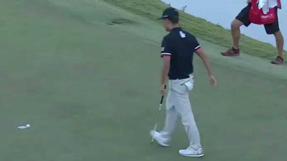 Kevin Na walks in a birdie putt on the first playoff hole of the Shriners.