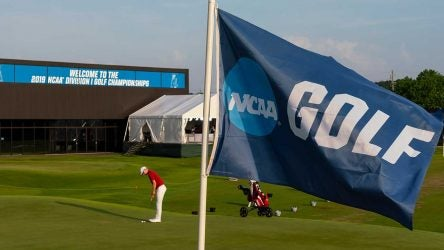 A player hits a putt at the NCAA Division I Championships.