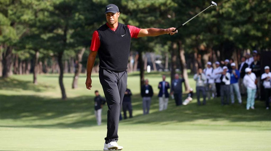 Tiger Woods raises his putter after winning the Zozo Championship on Monday in Japan.