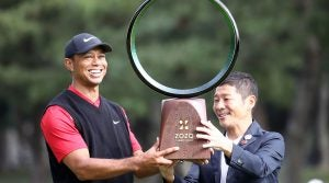 Tiger Woods finally accepts the Zozo Championship trophy after a lengthy ceremony.