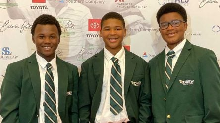 Three members of the Georgia state champion Drew Charter high school golf team.