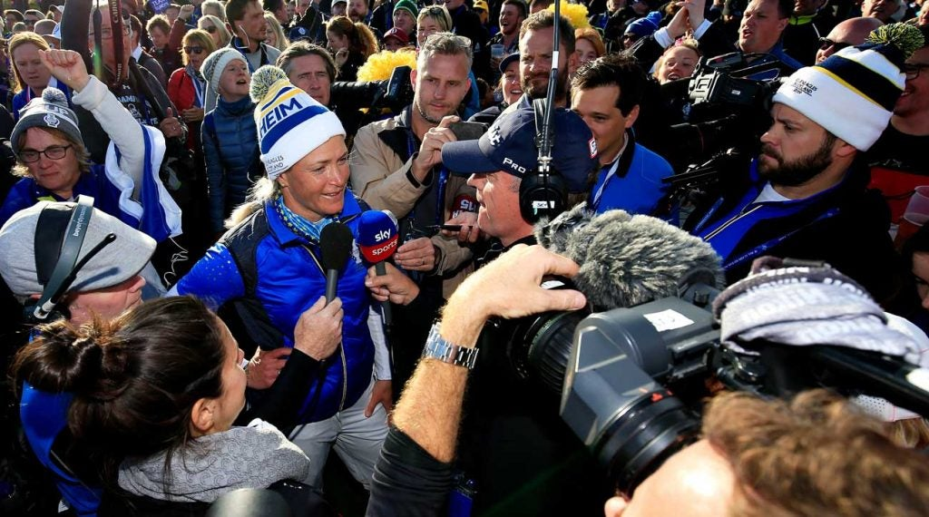 Suzann Pettersen surrounded by reporters at the Solheim Cup as she announces her retirement from pro golf.