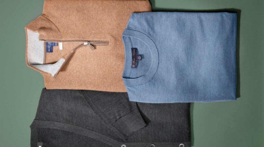 Golf sweaters: Uniqlo Extra-Fine Merino V-Neck Cardigan, $50; Peter Millar artisan Crafted cashmere flex quarter-zip, $598; Brooks Brothers BrooksTech Merino Wool Crewneck, $148.
