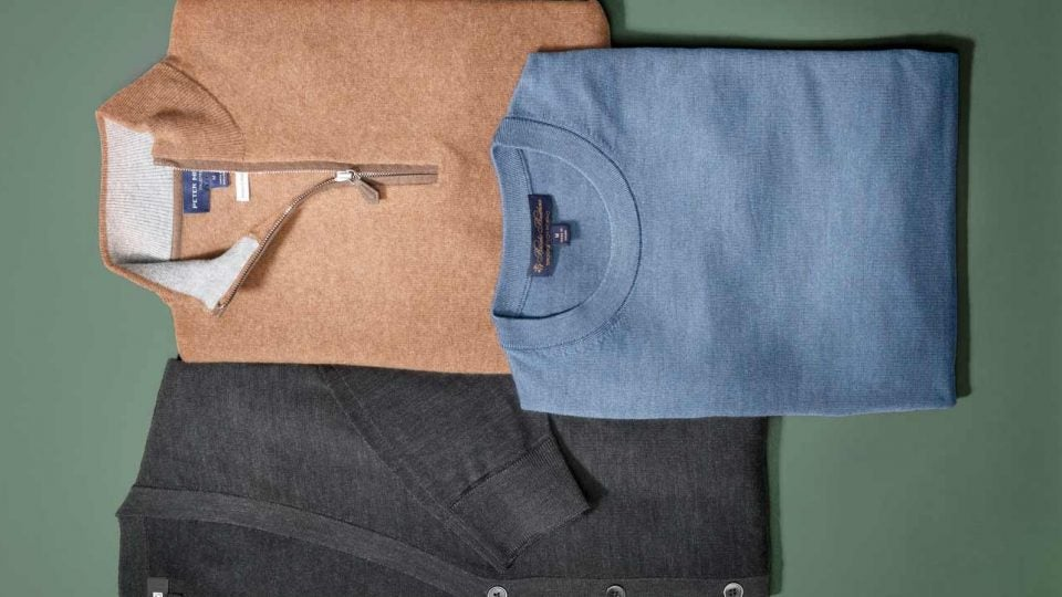 Golf sweaters: Uniqlo Extra-Fine Merino V-Neck Cardigan, $50; Peter Millar artisan Crafted cashmere flex quarter-zip, $598; Brooks Brothers BrooksTech Merino Wool Crewneck, $148.