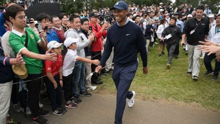 Tiger Woods smiles while walking to the eighth tee box during the MGM Resorts The Challenge: Japan Skins at Accordia Golf Narashino Country Club on Monday.