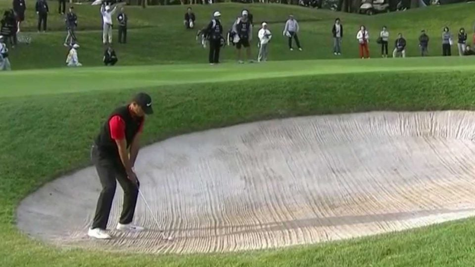 Tiger Woods blasts out of the bunker on Monday at the Zozo Championship.