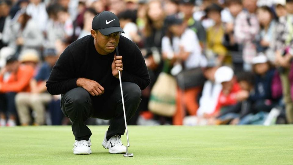 Tiger Woods reads a putt during the first round of the Zozo Championship. Woods shot 64 and is tied for the lead.