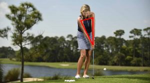 Maintain the triangle formed by your shoulders and arms at address throughout your motion. The club will hug the ground and catch every chip super-crisp.