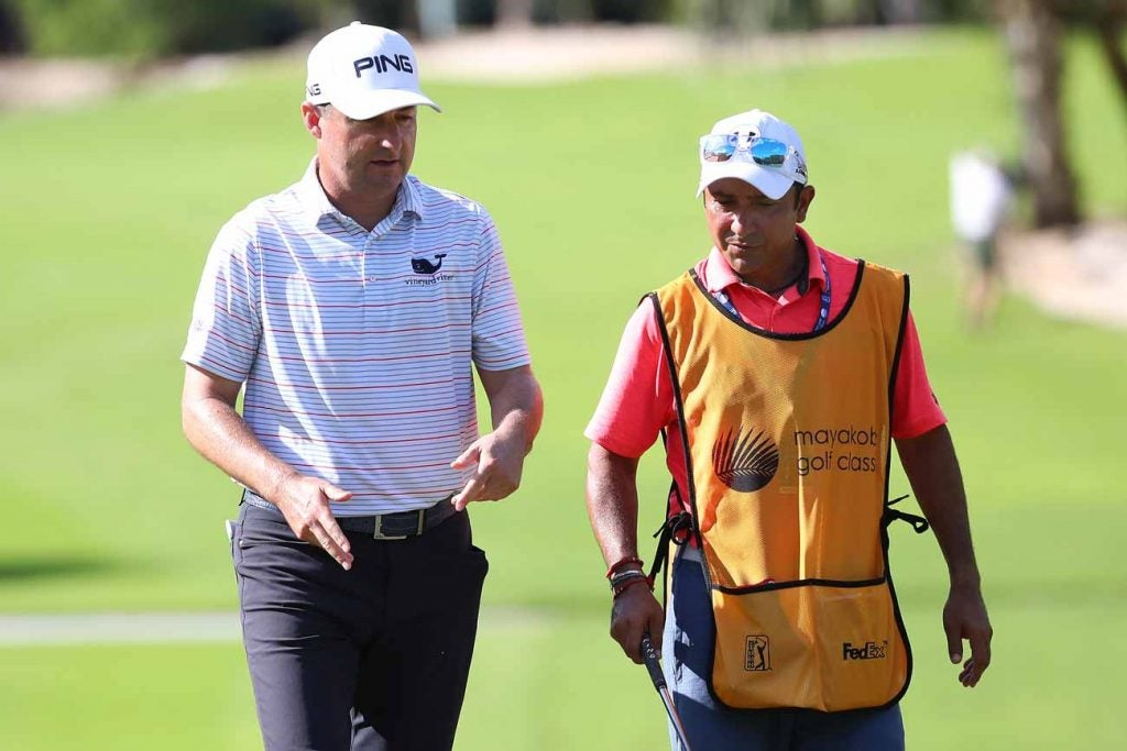 Rob Oppenheim walks with fill-in caddie David Ortiz at the Mayakoba Golf Classic.
