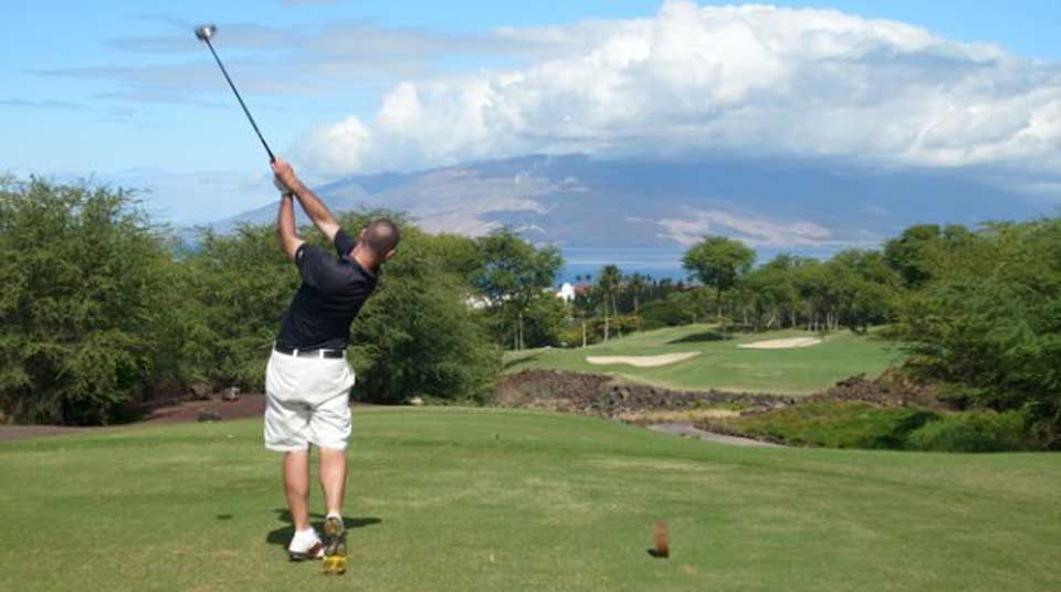 My husband, Paul, teeing off on one of Wailea's many scenic holes.