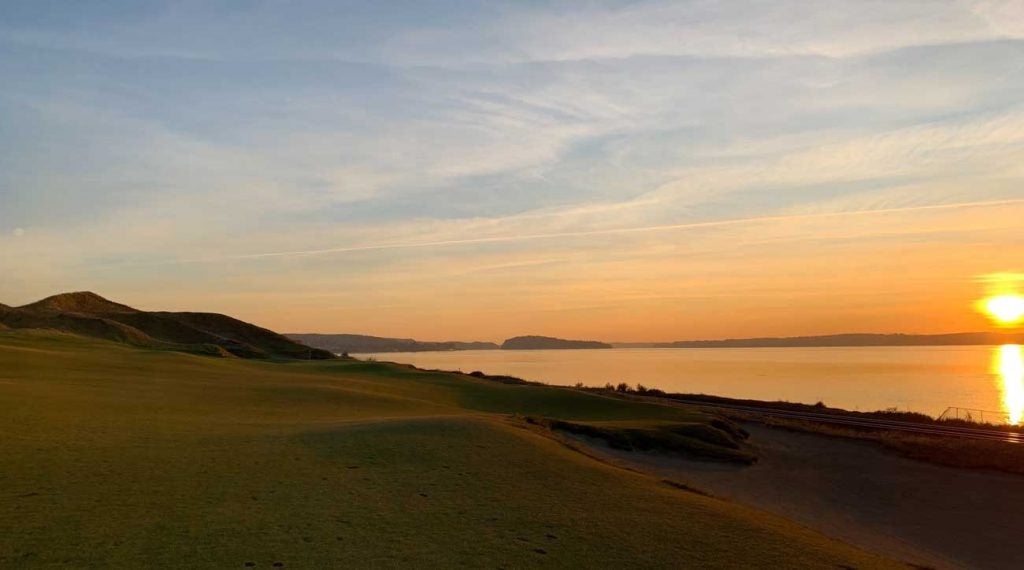 The sun setting over Puget Sound creates an incredible setting at Chambers Bay.
