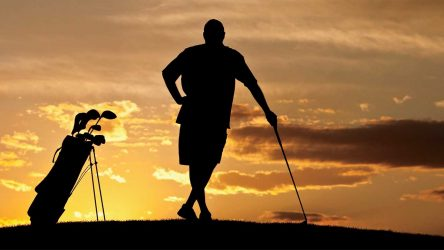 A golfer in the sunset