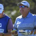 Mayfair with his caddie, Jeff Johnson, in the second round of Invesco QQQ Championship.