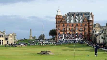 A golfer tees off at the Old Course at St. Andrews.