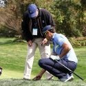 Rafa Cabrera-Bello speaks to a rules official.