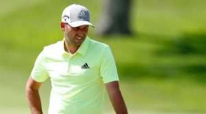 Sergio Garcia stares at a putt.
