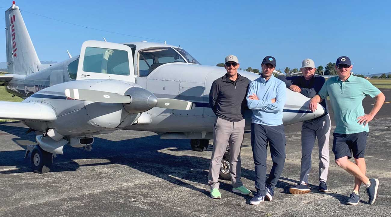 The foursome gets ready for a flight to their next adventure. We never said navigating all of these courses was easy.